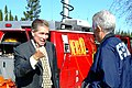 """(Severe Storms, Flooding, Mudslides, and Landslides) Vacaville, CA, Feb. 22, 2006- ABC 10 reporter Dave Marquis gives FEMA PIO John Treanor """"the thumbs up,"""" after an interview. Phot - DPLA - 26c595abe70ff70d84ebaf6cba0a9727.jpg"""