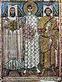 Ο Άγιος Δημήτριος ανάμεσα στον επίσκοπο και τον έπαρχο, που είναι οι ανακαινιστές του ναού. Ψηφιδωτό στον Άγιο Δημήτριο Θεσσαλον.jpg