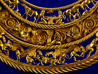 Scythians - Gold pectoral, or neckpiece, from a royal kurgan in Tolstaya Mogila, Pokrov, Ukraine, dated to the second half of the 4th century BC, of Greek workmanship. The central lower tier shows three horses, each being torn apart by two griffins.