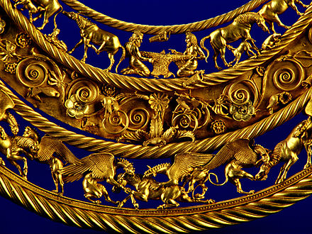 Gold Scythian pectoral, or neckpiece, from a royal kurgan in Pokrov, dated to the fourth century BC Fragmenty Pektorali.jpg