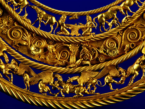 Gold pectoral, or neckpiece, from a royal kurgan in Tolstaya Mogila, Pokrov, Ukraine, dated to the second half of the 4th century BC, of Greek workmanship. The central lower tier shows three horses, each being torn apart by two griffins. Fragmenty Pektorali.jpg