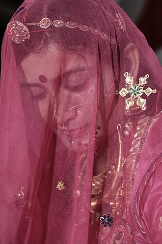 Ghoonghat - Bride in ghoonghat during Muh Dikhai ceremony, Rajasthan, India.