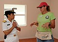 100428-N-1522S-004 RDML Michelle Howard speaks with Mary Lou Bowman Cubbin where 10 sailors are volunteering as part of Fleet Week Port Everglades.jpg