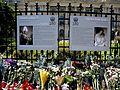 11. Bucuresti, Romania. Flori in memoriam Reginei Ana. Portretele Regelui Carol al II-a si a Reginei Mama Elena.jpg