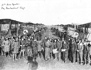 "11th Aero Squadron - 11th Aero Squadron posing with its Dayton-Wright DH-4s (Note ""Mr Jiggs"" on each fuselage), Maulan Airdrome, France, November 1918"