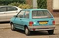1988 Mazda 121 1.1 DX (14769354572).jpg