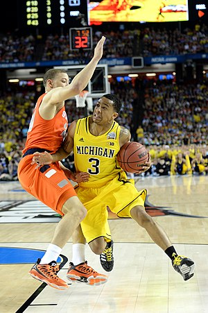 Brandon Triche - Triche in 2013, with Syracuse, defending against Trey Burke, in the 2013 NCAA Tournament.