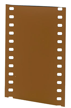 Color motion picture film - A strip of undeveloped 35 mm color negative.