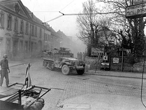 9th Armored Division (United States) - 9th AID M3 Half-tracks advancing through Engers, Germany, 27 March 1945.