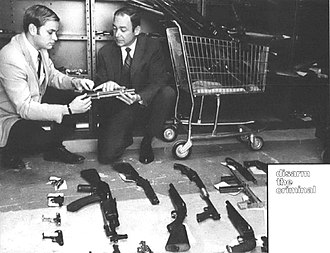Bureau of Alcohol, Tobacco, Firearms and Explosives - ATF investigators display weapons seized for violations of the Gun Control Act