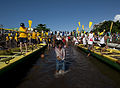 A child plays in the water as U.S. Sailors, partner nation service members and nongovernmental organization volunteers and members of the Samoan Don Bosco Longboat Rowing Team prepare to race during a cultural 130608-N-SK590-245.jpg