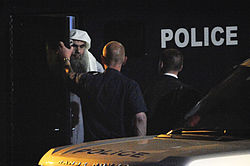 Abu Qatada steps out of the police van