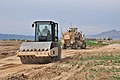 Afghan engineers work on a road construction project in Panjwa'i district at Forward Operating Base Shoja in Kandahar province, Afghanistan, March 28, 2013 130328-A-PV892-022.jpg
