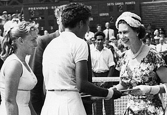 Althea Gibson - Queen Elizabeth II presents Gibson with the Venus Rosewater Dish at the 1957 Wimbledon women's singles championships (July 6, 1957).