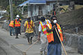 American Samoan civilians clear debris from the sideway along the main road during cleanup efforts in Pago Pago, American Samoa, Oct. 1, 2009 091003-F-LX971-376.jpg