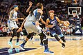 Angel McCoughtry (35) drives towards the basket as she's guarded by Minnesota Lynx players.jpg