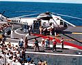 Apollo 16 crew exits recovery helicopter aboard Ticonderoga.jpg