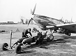 Armourers loading bombs onto a Spitfire Mk XVI of No. 603 Squadron RAF at Ludham in Norfolk, March 1945. CH14808.jpg