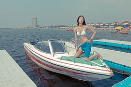 Attractive asian model on a boat. (6772356299).jpg