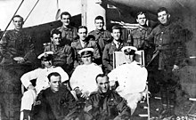 A group portrait of ten soldiers and three sailors on board a ship