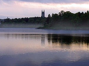 Boston College's Gasson Hall building across the Chestnut Hill Reservoir