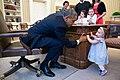 Barack Obama holds the hand of Lincoln Rose Pierce Smith, 2014.jpg