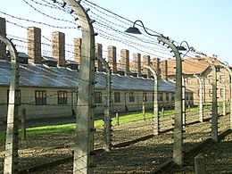Barbed wire near by the entrance of Auschwitz I.jpg