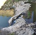 Beaver dam partially blown out at fish ladder at Jalama Weir below U. S. Highway 1 2014-04.jpg