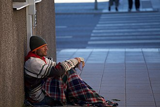 Begging - A beggar in Uppsala, Sweden. June 2014.