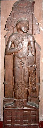 Indian relief of possible Indo-Greek king, with Buddhist triratana symbol on his sword