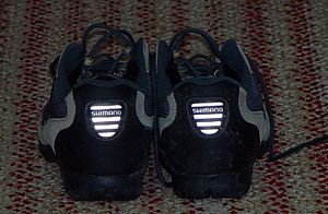 Retroreflector - Retroreflectors are clearly visible in a pair of bicycle shoes. Light source is a flash a few centimeters above camera lens.