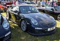Black 997 GT3 RS with Porsche RS Spyder design center lock wheels.jpg