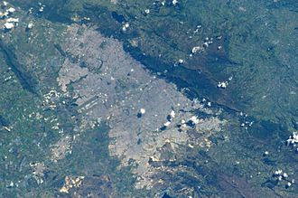 Eastern Hills, Bogotá - The Eastern Hills are clearly visible on this photo of Bogotá; the darker green elevated areas bordering the Colombian capital. North is in the upper left of the image.