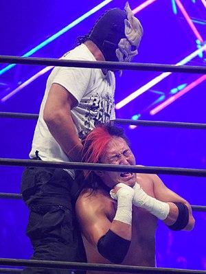 Captain New Japan - Hirasawa as Bone Soldier, choking Yoshitatsu in November 2016