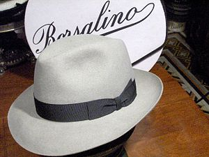 "Fedora - A fedora made by Borsalino with a gutter-dent, side-dented crown, the front of the brim ""snapped down"" and the back ""snapped up"""