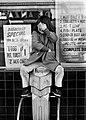 Boy eating candy on scale 1973 Daniel D. Teoli Jr..jpg