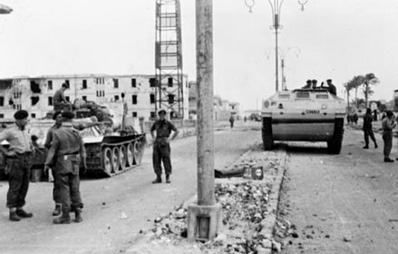A British link up between the 3rd Battalion, The Parachute Regiment, and the Commandos at the Coast Guard barracks in Port Said. The paratroopers have with them a captured SU-100 tank destroyer, and the Commandos a Buffalo amphibious assault vehicle. British tanks in Port Said.jpg