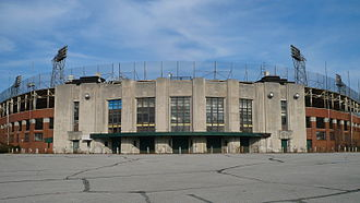 Bush Stadium - Bush Stadium in 2009 prior to the demolition of the grandstands. The light tower and facade have since been incorporated into a new building.