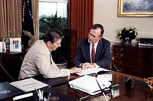 United States support for Iraq during the Iran–Iraq war - President Ronald Reagan and Vice President George H. W. Bush work in the Oval Office of the White House, July 20, 1984.