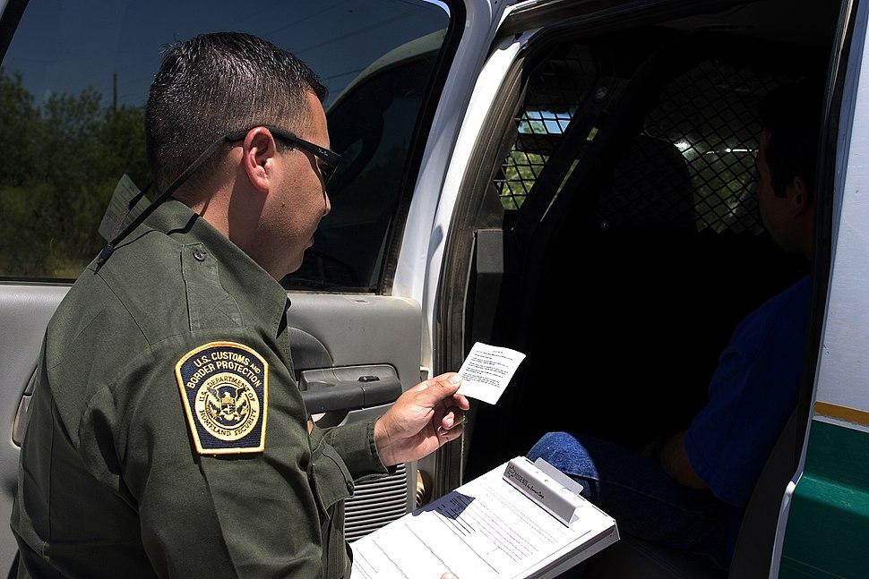 CBP Border Patrol agent reads the Miranda rights