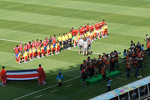 Football in Costa Rica - Costa Rica and England teams line up for national anthems at Mineirão stadium in Belo Horizonte during their match at the FIFA World Cup 2014, Brazil.