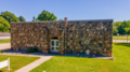 CWA Leonidas Stone School Front of building from Drone.png