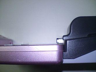 Nintendo e-Reader - The e-Reader plugged into a Game Boy Advance SP.