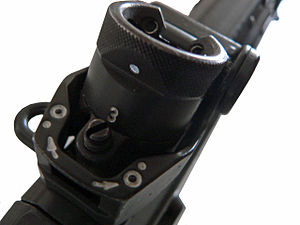 "Iron sights - Rear, rotating diopter drum sight of a SIG SG 550 assault rifle. The viewing aperture above the ""3"" (denoting the 300 m setting) can be seen"