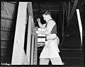 Carpenter on Dog Box door Otahuhu. PHOTOGRAPHER J.F. Le Cren DATE 1953 2.jpg