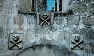"""At Mission Santa Barbara, a religious outpost founded in California in 1786, stone """"skull and crossbone"""" carvings denote the cemetery entrance."""