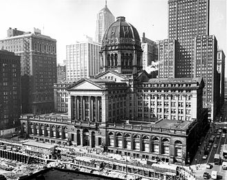 Chicago Federal Building - The Chicago Federal Building looking southwest from Adams and Dearborn Streets with the Chicago Board of Trade Building visible behind the dome