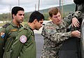 Chief Warrant Officer Robert Phillips familiarizes Maj. DK Chaudhary and Lt. Col. Sanjay Vadhera with the OH-58D Kiowa Warrior in preparation for a demonstration flight.jpg