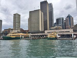 Circular Quay ferry wharf - View towards the wharf, railway station and surrounding buildings from Sydney Cove