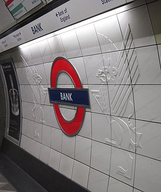 Bank and Monument stations - Wall tiles at the station show the supporters of City of London coat of arms, combined with the Underground Roundel